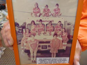 Janice Crumpley-Bluebaum holds a photo of the 1972 Foremost team. That's here in front of the truck, to the left. Look atop the photo, and the girl on the left is none other than Linda Dollar, former Missouri State volleyball coach and MSHOF inductee.