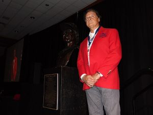 Tony La Russa stands next to the specially commissioned bronze bust that will soon debut on the Legends Walkway. The Hall named La Russa a Missouri Sports Legend on Wednesday.