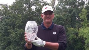 John Cyrus holds the winning trophy from the Masters Division regional of the Callaway Long Drive Series.