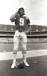 Kansas City Chiefs quarterback Bill Kenney (9) talks on the headset during a 1984 NFL game.