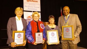 Inductees: From left, former University of Missouri women's basketball coach Joann Rutherford, President's Award winner Jodie Adams (former director of the Springfield-Greene County Park Board), former Lockwood and Pleasant Hope high school volleyball coach Cheryl Shores and Evangel University women's basketball coach Leon Neal. Not pictured – former Missouri Southern State University Athletic Director Sallie Beard.