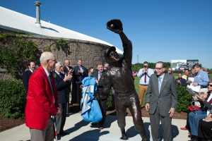 Bill Virdon, red jacket, reacts as the cover to his larger-than-life statue is revealed Thursday, May 25, 2017.
