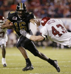 Missouri's Brad Smith stiff-arms Arkansas' Caleb Miller during the second half of Arkansas' 27-14 win over Missouri in the Independence Bowl at Independence Stadium in Shreveport, La., on Wednesday, Dec. 31, 2003. 2003 Independence Bowl - Missouri vs. Arkansas Independence Stadium Shreveport, Louisiana United States December 31, 2003 Photo by David Yerby/WireImage.com To license this image (1985637), contact WireImage: +1 212-686-8900 (tel) +1 212-686-8901 (fax) st@wireimage.com (e-mail) www.wireimage.com (web site)