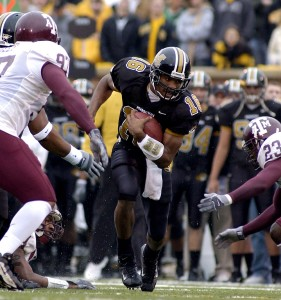 Missouri quarterback Brad Smith found a hole in the Texas A&M line and ran for 10-yards and a first down during first quarter action at Faurot Field in Columbia, Missouri, November 15, 2003. The Tigers won, 45-22. Texas A&M Aggies vs Missouri Tigers Faurot Field Columbia, Missouri United States November 15, 2003 Photo by BarryTaylor/WireImage.com To license this image (1827984), contact WireImage: +1 212-686-8900 (tel) +1 212-686-8901 (fax) st@wireimage.com (e-mail) www.wireimage.com (web site)