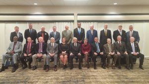 Front row, left to right: Willie Bowie, Bob Dernier, Ron Hall, Jim Aziere, Lori Hanaway, Chairman Leon Combs, Diana Tingler, Chip Sherman, Darrel Gourley, Frank Boal, Dr. Jon Browne. Back row, left to right: Executive Vice President Marty Willadsen, Bill Maas, Bob Glasgow, Kevin Seitzer, coach Mel Tjeerdsma representing Northwest Missouri State's 1998 & 1999 national championship football teams, Martin Rucker, Don Walsworth, Phillip Snowden, James Roberts and President & Executive Director Jerald Andrews.