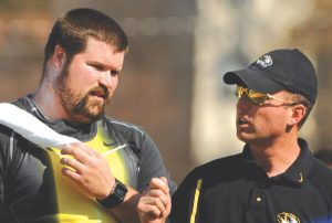 Christian Cantwell talks with coach Brett Halter during the shot put in the 80th Kansas Relays at Memorial Stadium in Lawrence, Kan. on Friday, April 20, 2007. Cantwell won with a throw of 68-6 (20.66m).